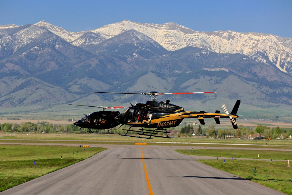 HOVERING 3 HELICOPTERS IN CLOSE PROXIMITY AND SETTING UP FOR A PHOTO SHOOT DEMANDS GOOD COMMUNICATION AND SKILL - BRIDGER MOUNTAINS IN THE BACKGROUND - I'M USING A WIDE ANGLE LENS AND WE ARE ALL 'HOVERING SIDEWAYS'