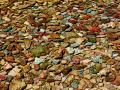 GLACIER PARK'S LAKES, RIVERS AND STREAMS ARE LOADED WITH RAINBOW COLORED ROCKS THAT FORM VERY COOL ABSTRACT  PATTERNS