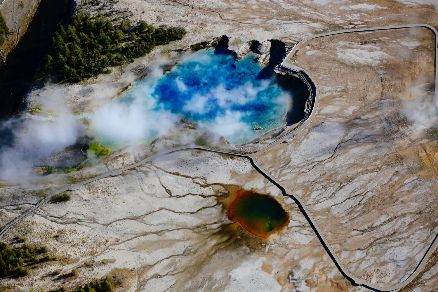 "AERIAL -ZOOM LENS-""EXCELSIOR GEYSER POOL"" AND VENT-""YELLOWSTONE NATIONAL PARK"" HAS MANY SECRETS YET TO BE DISCOVERED AND UNDERSTOOD"