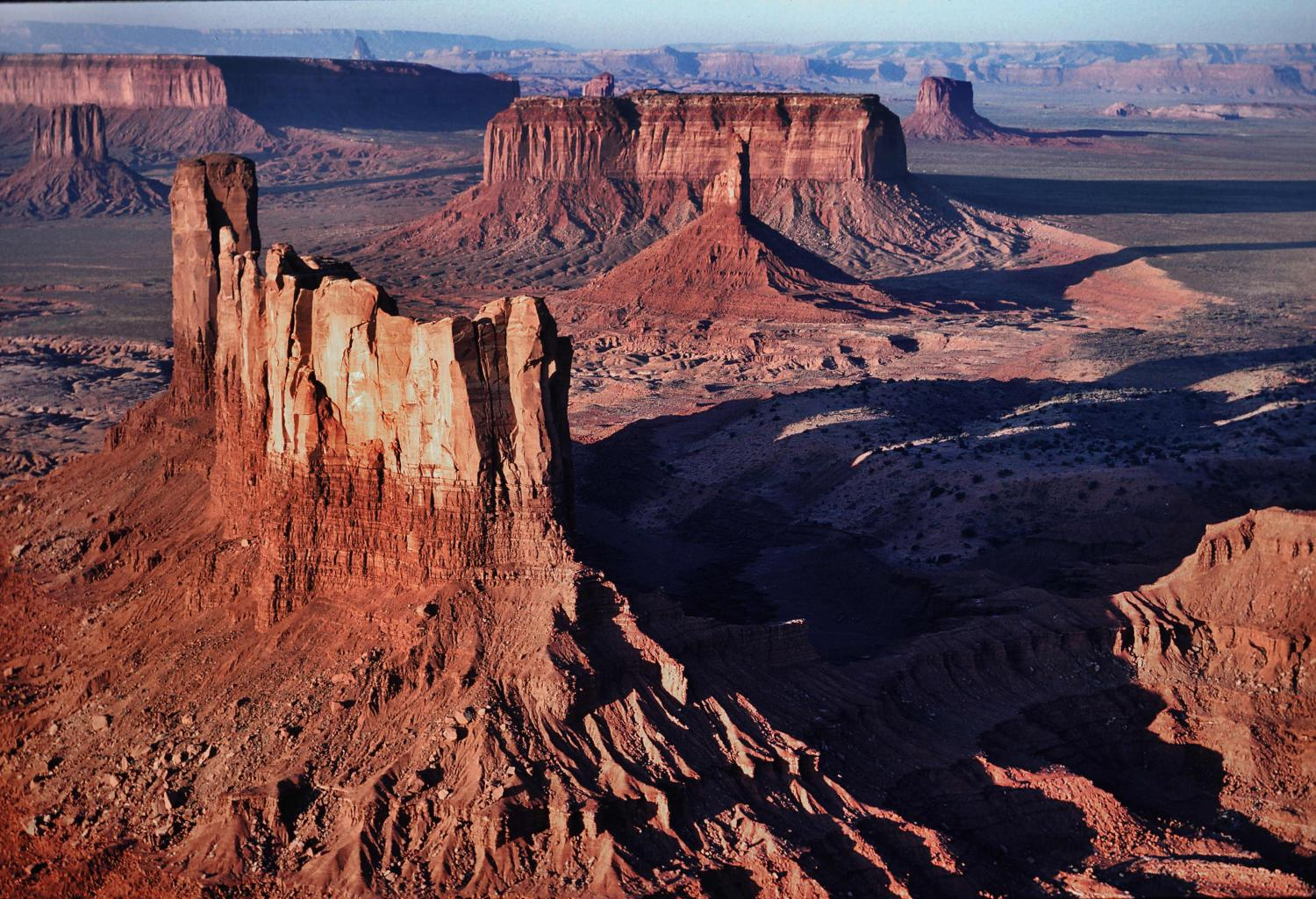 MONUMENT VALLEY AERIAL -THIS WHOLE AREA OF SOUTHERN UTAH HAS SOME OF THE MOST COMPLETE LEGENDS OF GIANTS, MONSTERS AND STARGATES