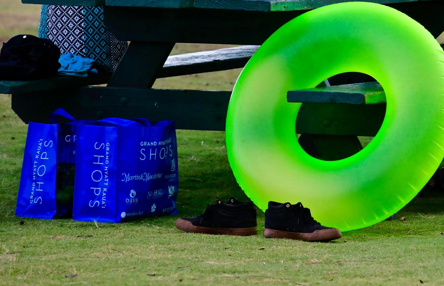 """MAXIMUM CONTRAST""-THIS NEON GREEN  BEACH TUBE,AGAINST THE BLUE SHOPPING BAGS DREW MY ATTENTION AS I WAS WALKING DOWN THE BEACH. I NEED TO GET A SHIRT WITH THESE COLORS!"