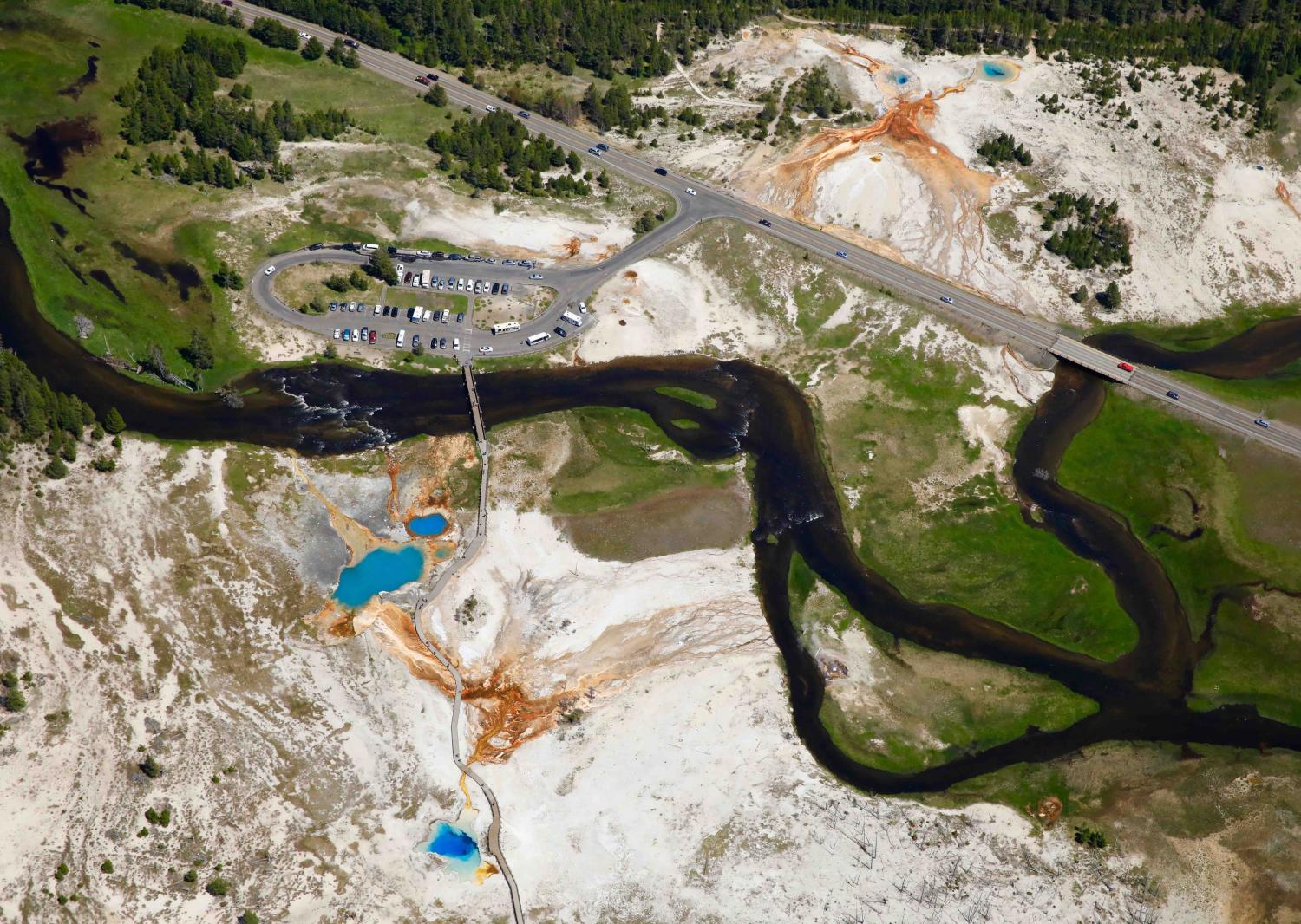 """THIS YEAR YELLOWSTONE NATIONAL PARK IS PROJECTED TO BREAK ALL RECORDS FOR ATTENDANCE. AERIAL OF """"BISCUIT GEYSER BASIN"""""""