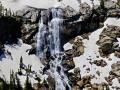 SPRING WATERFALLS IN THE GRAND TETON MOUNTAINS, WYOMING - FINALLY SPRING MELT IS UNDER WAY IN THE HIGH COUNTRY-AERIAL