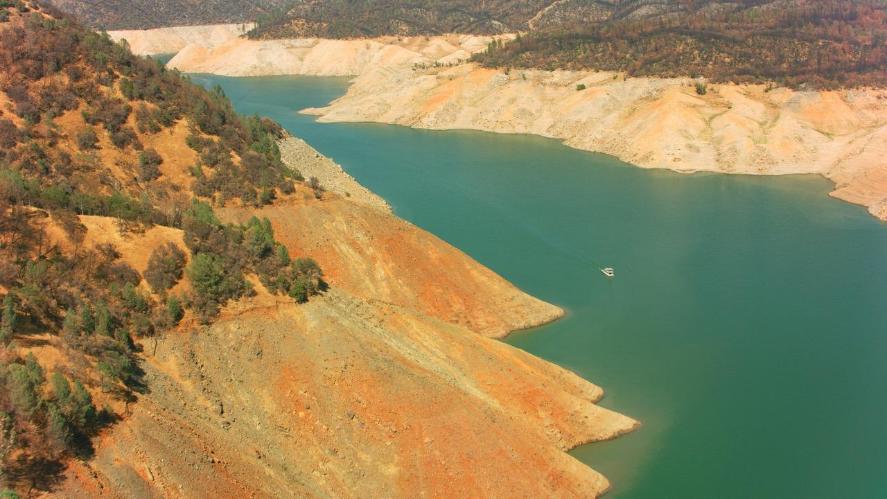 """LAKE OROVILLE DAM VIDEO  8/3/21 STILL FRAME FROM OUR MOVIE :""""MEGA-DROUGHT AND VANISHING WATERS""""- HYDRO ELECTRIC GENERATORS SHUT DOWN: POWER FIRST THEN NO WATER  - COPYRIGHT GEN 6"""